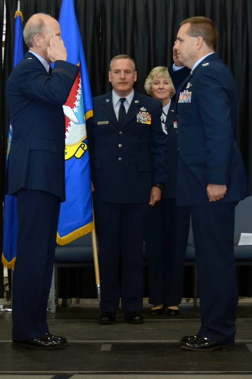 """U.S. Air Force Col. Shawn """"Rob"""" Burrus (right) assumes command of the 157th Air Refueling Wing from Maj. Gen. William N. Reddel, III, the N.H. Adjutant General, during a change of command ceremony, Pease Air National Guard Base, N.H., Oct. 5, 2014. This ceremony signified command of the wing changing from Col. Paul Hutchinson to Burrus. (Air National Guard photo by Airman 1st Class Kayla McWalter/RELEASED)"""