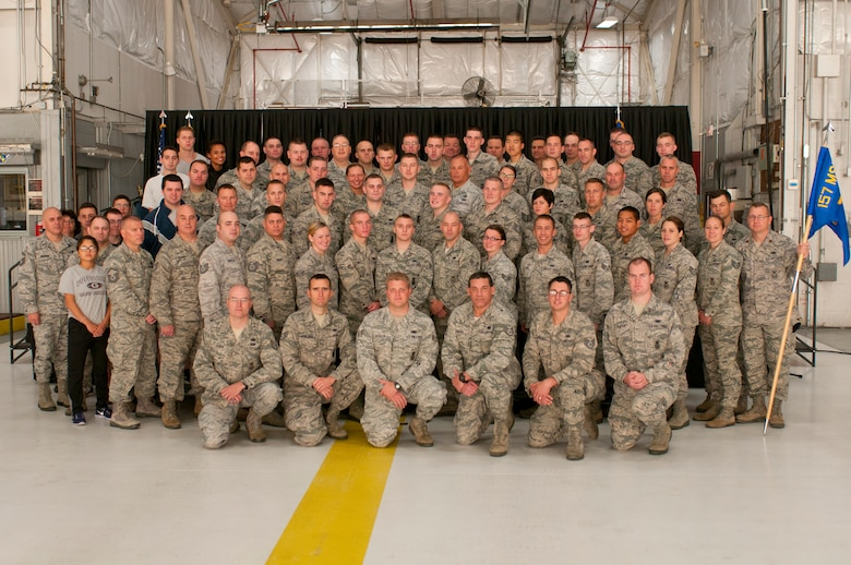 Members of the 157th Security Forces Squadron pose for a photograph after the squadron's change of command ceremony at Pease Air National Guard Base, N.H. Oct. 3, 2014.  Maj. Kenneth Leedberg relinquished command of the squadron to Maj. Jassen Bluto. (U.S. Air National Guard photo by Staff Sgt. Curtis J. Lenz)