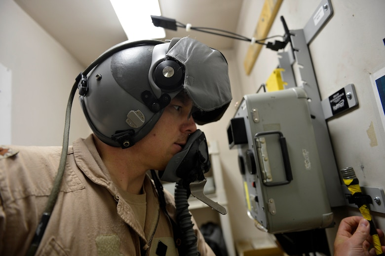 U.S. Air Force Maj. Vincent Sherer, 455th Air Expeditionary Wing pilot, checks his equipment before a sortie at Bagram Airfield, Afghanistan Aug. 5, 2014.  Sherer flies the A-10 Thunderbolt II to provide overwatch and close air support to ground forces. He is deployed from Davis-Monthan Air Force Base, Ariz. and a native of Portland, Ore. (U.S. Air Force photo by Staff Sgt. Evelyn Chavez/Released)