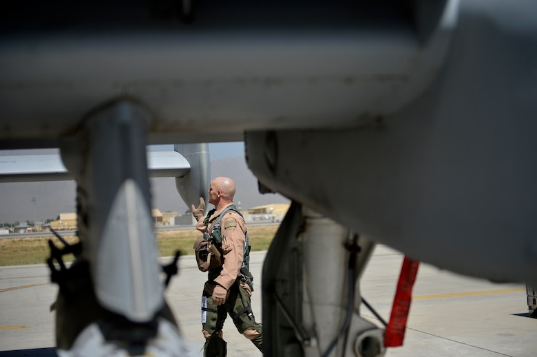 U.S. Air Force Maj. Vincent Sherer, 455th Air Expeditionary Wing pilot, inspects an A-10 Thunderbolt II aircraft at Bagram Airfield, Afghanistan Aug. 5, 2014.  Sherer flies the A-10 to provide overwatch and close air support to ground forces. Sherer is deployed from Davis-Monthan Air Force Base, Ariz. and a native of Portland, Ore. (U.S. Air Force photo by Staff Sgt. Evelyn Chavez/Released)