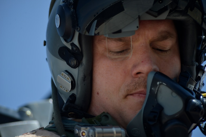U.S. Air Force Maj. Vincent Sherer, 455th Air Expeditionary Wing pilot, prepares for a sortie at Bagram Airfield, Afghanistan Aug. 5, 2014.  Sherer flies the A-10 Thunderbolt II, a specialized ground-attack aircraft that provides close air support to ground forces operating in Afghanistan.  He is deployed from Davis-Monthan Air Force Base, Ariz. and a native of Portland, Ore. (U.S. Air Force photo by Staff Sgt. Evelyn Chavez/Released)