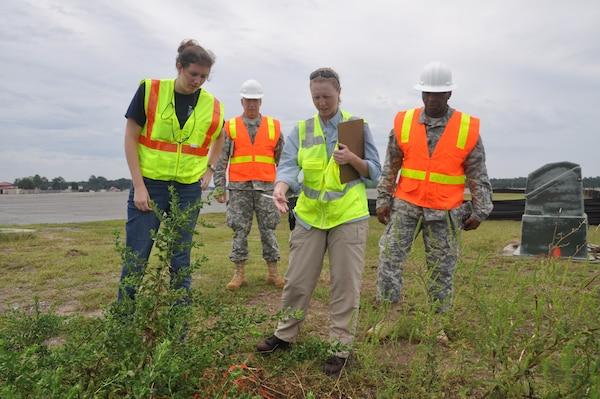 Piper Bazemore, Sgt. Maj. Mark Andrews, Sue Wilcox and Command Sgt. Maj. Antonio Jones (left to right) conduct an airfield assessment during training exercises on Hunter Army Airfield held Sept. 22. During the last week of training, members split into two teams to conduct collective training exercise which included airfield assessments and bridge reconnaissance. The 542nd Engineer Detachment Forward Engineering Support Team - Advanced is ensuring deployment readiness by January 2015 (USACE photo by Chelsea Smith).
