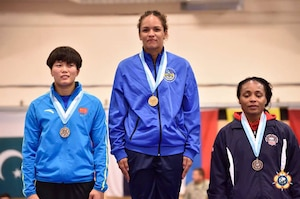 Iris Smith (Right) wins the bronze medal in the Women's Freestyle 75kg competition at the 29th CISM World Military Wrestling Championship at Joint Base McGuire-Dix-Lakehurst, New Jersey 1-8 October 2014.