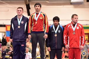 Army Sgt. Moza Fay (left) wins silver in the 74kg Freestyle competition at the 29th CISM World Military Wrestling Championship at Joint Base McGuire-Dix-Lakehurst, New Jersey 1-8 October 2014