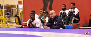 Assist Coach Gunnery Sgt. James Shillow (left) and Mr. Jason Loukides watch during the Greco-Roman competition at the 29th CISM World Military Wrestling Championship at Joint Base McGuire-Dix-Lakehurst, New Jersey 1-8 October 2014