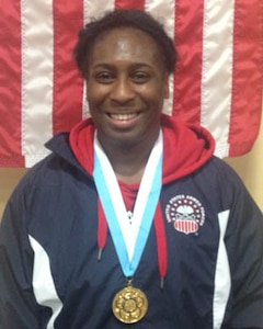 Army Sgt. Randi Miller Strike Gold in the Women's Freestyle 69kg competition at the 29th CISM World Military Wrestling Championship at Joint Base McGuire-Dix-Lakehurst, New Jersey 1-8 October 2014
