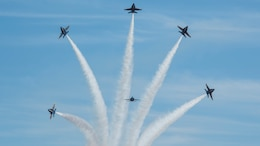 The Navy Blue Angels fly in formation during the 2014 Marine Corps Air Station Miramar Air Show, Oct. 3. The Blue Angels is comprised of 16 officers who serve voluntarily.
