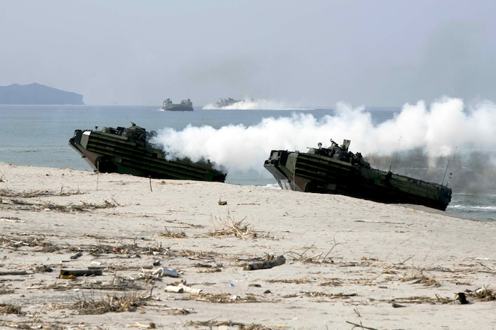 Philippine and U.S. Marines loaded in U.S. Marine Amphibious Assault Vehicles hit the beach during a mechanized assault in Amphibious Landing Exercise 15 at Naval Education and Training Command, Zambales, Luzon, Philippines, Oct. 5. PHIBLEX is an annual, bilateral training exercise conducted by members of the Armed Forces of the Philippines alongside U.S Marine and Navy Forces focused on strengthening the partnership and relationships between the two nations across a range of military operations including disaster relief and complex expeditionary operations. The U.S. Marines are with Company I, Battalion Landing Team 3rd Battalion, 5th Marines, 31st Marine Expeditionary Unit, 3rd Marine Expeditionary Brigade. The Philippine Marines are with 4th Marine Company, Battalion Landing Team - 9.