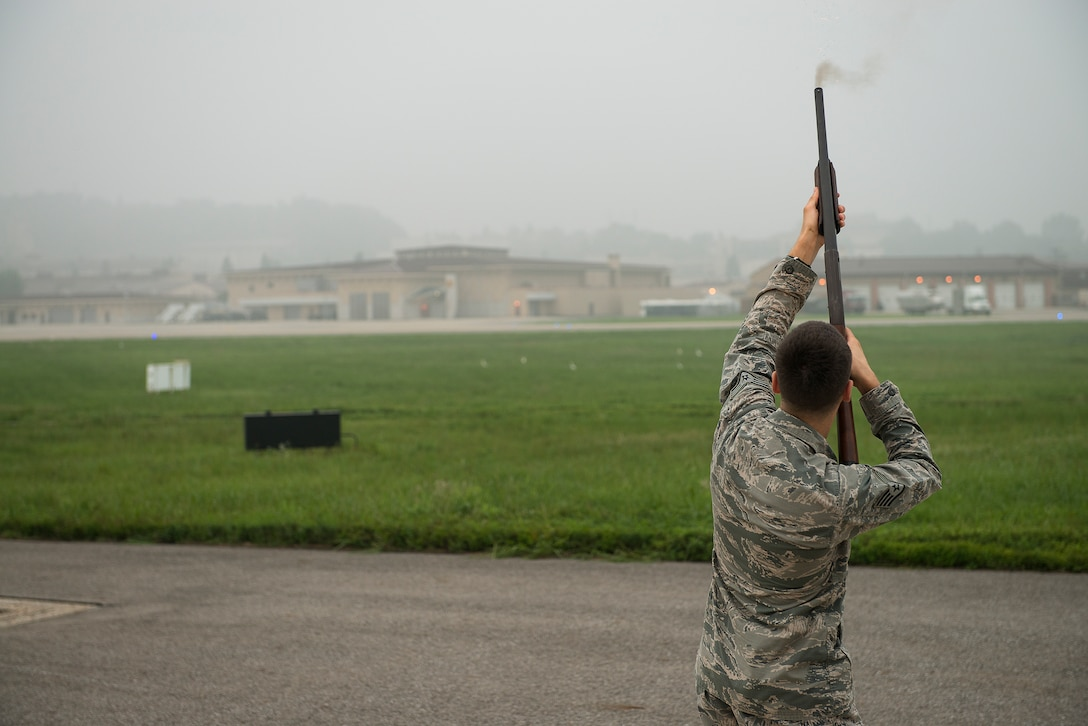 Staff Sgt. Joshua Johnson, a 51st Operations Support Squadron airfield management operations supervisor, fires a blank round into the air to ward birds off of the flight line Aug. 23, 2014, at Osan Air Base, Republic of Korea. As part of the airfield management team, Johnson is responsible for ensuring birds stay away from the flight line during after-duty and weekend hours. (U.S. Air Force photo by Staff Sgt. Jake Barreiro/Released)
