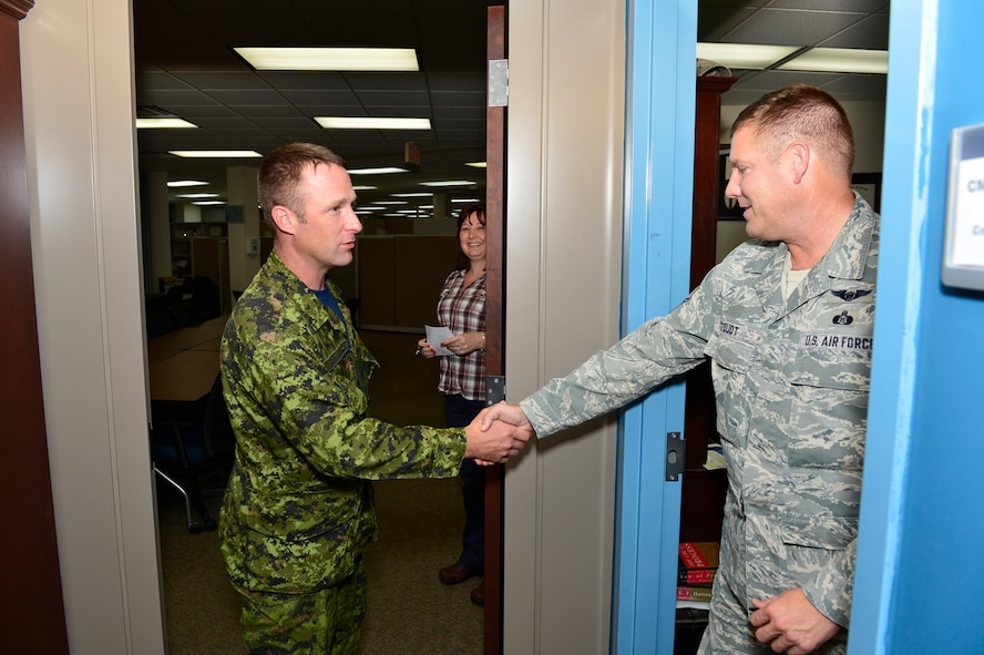 "MCGHEE TYSON AIR NATIONAL GUARD BASE, Tenn.  - Canadian Sergeant Brian Standing shakes hands with Chief Master Sgt. Thomas ""TK"" Stoudt, commandant of the Paul H. Lankford Enlisted PME Center here Oct. 6, 2014, at the I.G. Brown Training and Education Center. Standing was attending U.S. Air Force NCO Academy and interviewed for the Commandant Award. (U.S. Air National Guard photo by Master Sgt. Jerry Harlan/Released)"
