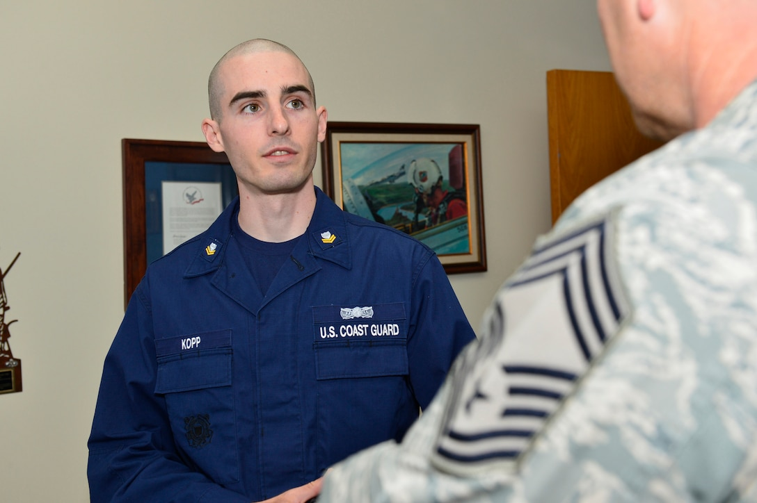 """MCGHEE TYSON AIR NATIONAL GUARD BASE, Tenn.  - Coast Guard Petty Officer 2nd Class John Kopp interviews for the Commandant's Award with Chief Master Sgt. Thomas """"TK"""" Stoudt, commandant of the Paul H. Lankford Enlisted PME Center here Oct. 6, 2014, at the I.G. Brown Training and Education Center. Kopp was attending U.S. Air Force NCO Academy. (U.S. Air National Guard photo by Master Sgt. Jerry Harlan/Released)"""
