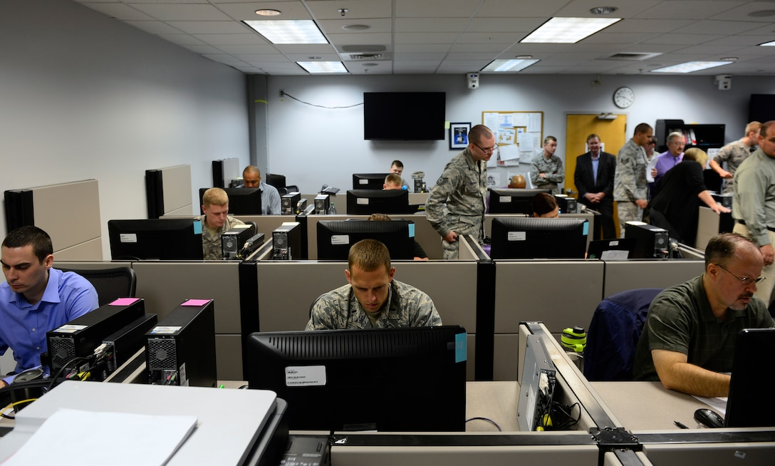 Students of the Network War Bridge Course participate in a class exercise conducted by the 39th Information Operations Squadron, Hurlburt Field, Fla., Sept. 19, 2014. The Network War Bridge Course provides a foundation for new cyber operations students transferring from other career fields.  Air Force Space Command provides trained and ready cyber forces to the warfighter through 24th Air Force.  (U.S. Air Force photo by Airman 1st Class Krystal Ardrey)