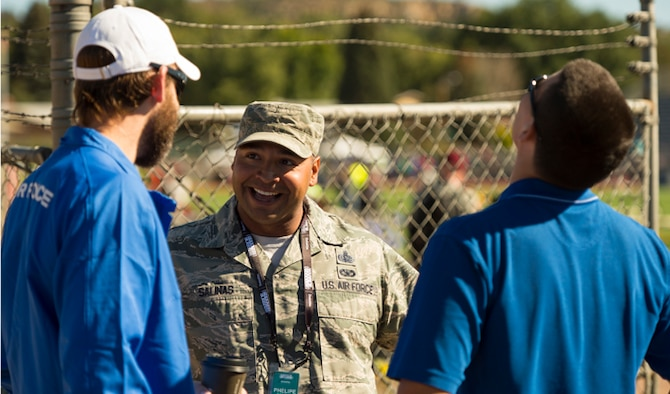 Master Sgt. Phelipe Salinas speaks to his athletes during the 2014 Warrior Games at the Garry Berry Stadium Oct. 2, 2014, in Colorado Springs, Colo. Salinas is the first sergeant for the Air Force team and has filled this position for the past two years. The Warrior Games consists of athletes from throughout the Defense Department, who compete in Paralympic-style events. The goal of the games is to help highlight the limitless potential of warriors through competitive sports. (U.S. Air Force photo/Master Sgt. Charles Larkin Sr.)