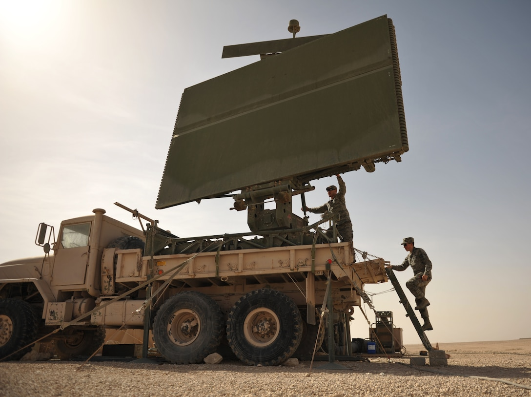 Senior Airman Joseph Fletcher and Airman 1st Class Christopher Kelly inspect a TPS-75 radar March 13, 2012, in Southwest Asia. The radar site contributes to the overall picture that the operators see inside an operations center. Fletcher and Kelly are radar maintenance technicians with the 71st Expeditionary Air Control Squadron. (U.S. Air Force photo/Staff Sgt. Nathanael Callon)