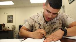 Pfc. Pablo Zacari, administrative clerk with 9th Marine Corps District works on a submission to the unit diary, Oct. 6, 2014. Zacari is proud of what he does in the Marine Corps and plays a vital role in the administrative support of the district headquarters.
