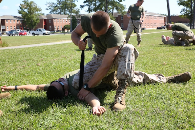 Marines with the Ground Combat Element Integrated Task Force practice lifting and carrying a Marine on a stretcher during the combat lifesaver course outside of the task force headquarters at Marine Corps Base Camp Lejeune, North Carolina, Oct. 1, 2014. During day one, Marines applied proper carries, drags and movement. From October 2014 to July 2015, the GCEITF will conduct individual and collective level skills training in designated ground combat arms occupational specialties in order to facilitate the standards based assessment of the physical performance of Marines in a simulated operating environment performing specific ground combat arms tasks. (U.S. Marine Corps photo by Cpl. Paul S. Martinez/Released)
