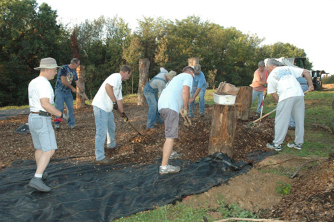 Volunteers creating Playscape at Lake Red Rock
