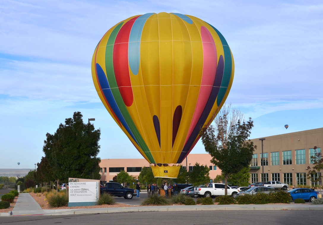 ALBUQUERQUE, N.M., -- During the Albuquerque International Balloon Fiesta a hot air balloon lands in the District Office's parking lot, Oct. 7, 2014.