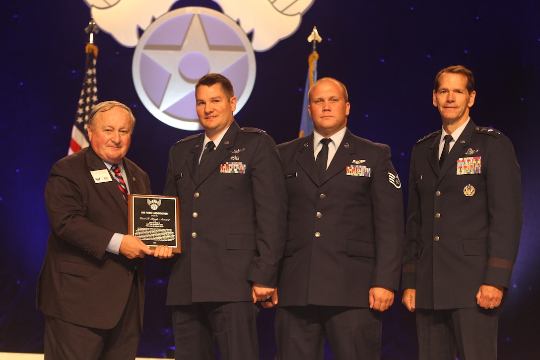 Capt. Rory Cattelan, a pilot with the 128th Air Refueling Wing and Staff Sgt. Tyson Krug, a boom operator with the 128 ARW, receive the AFA Earl T. Ricks Award, which is given to Air National Guard members who have demonstrated outstanding airmanship, from Air Force Association at the 2014 Air & Space Conference and Technology Exposition in Washington D.C. Sept. 18, 2014.