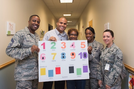 Members of the Joint Base Charleston Multicultural Committee pose for a photo Oct. 7, 2014, at the Child Development Center on Joint Base Charleston, S.C. Committee members read Spanish to children at the CDC  in celebration of Hispanic Heritage Month, which runs through Oct. 15. The Multicultural Committee's mission is to enhance cross-cultural awareness and to promote diversity among all military members, civilian employees, family members and retirees. (U.S. Air Force photo/Senior Airman George Goslin)