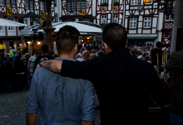 U.S. Air Force Senior Airman Edward Lomelin, 606th Air Control Squadron radio frequencies transmission systems technician and native of Austin, Texas, and U.S. Air Force Airman 1st Class Chris Lomelin, 606th ACS power production technician and native of Austin, Texas, attend a wine festival in Bernkastel-kues, Germany, Sept. 6, 2014. Edward, Chris' older brother, helped influence Chris to join the military. After his technical training, Chris was sent to Spangdahlem Air Base, Germany, where he was placed in the same squadron as his brother. (U.S. Air Force photo by Airman 1st Class Kyle Gese/Released)
