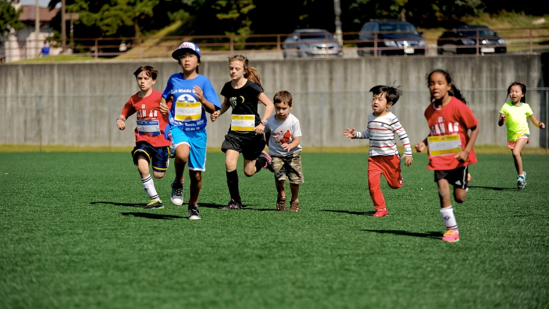 Children participate in a children's race during a Friendship Fun Run Oct. 4, 2014 at Osan Air Base, Republic of Korea.  In addition to the children's race, the run featured a half marathon, 10K, 5K and kids' relay.  The run was hosted by the 607th Air Operations Center and its Good Neighbors.  More than 300 U.S. and Korean participants registered for the run.  (U.S. Air Force photo by Maj. John Ross)