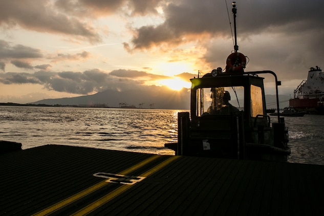 Cpl. Andrew W. O'Malley pilots a Bridge Erection Boat while maneuvering an Improved Ribbon Bridge component during ship-to-shore transport operations Sept. 23 in logistical support of Amphibious Landing Exercise 2015 in Subic Bay, Philippines. The operation proved the concept that IRB components can be used in conjunction with BEBs on the open ocean as a ship-to-shore connector for transporting supplies and equipment to Marines on shore. PHIBLEX is an annual bilateral training exercise conducted by the Armed Forces of the Philippines alongside U.S. Marine and Navy forces. The Marines are combat engineers with 9th Engineer Support Battalion, 3rd Marine Logistics Group, III Marine Expeditionary Force, currently assigned to Combat Logistics Detachment 379, Headquarters Regiment, 3rd MLG, III MEF. T-AKE 14-2 is a maritime pre-positioned force, multi-country theater security cooperation event that deployed from Okinawa aboard the USNS Sacagawea to participate in training exercises throughout the Asia-Pacific area of operations. (U.S. Marine Corps photo by Cpl. Drew Tech/Released)