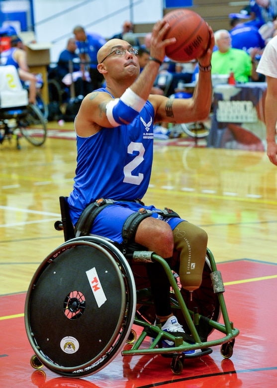 Master Sgt. Christopher Aguilera warms up before a game against Navy in the first wheelchair basketball game of the 2014 Warrior Games Sept. 29, 2014, at the U.S. Olympic Training Center in Colorado Springs, Colo. The Air Force team lost 38-19 and will play the U.S. Special Operations Command in the next round. (U.S Air Force photo/Staff Sgt. Devon Suits)