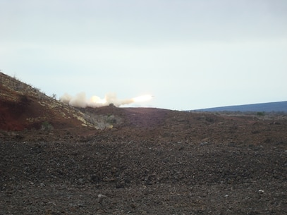 A M142 HIMARS launcher from Battery R fires a M28A2 rocket during a live fire training event at Pohakuloa Training Area, Hawaii.