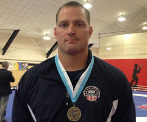 Marine Staff Sgt. David Arendt (Camp Lejeune, NC) with his bronze medal after competing in the 130 kg Greco-Roman competition at the 29th CISM World Military Wresting Championship at Joint Base McGuire-Dix-Lakehurst, New Jersey 1-8 October.