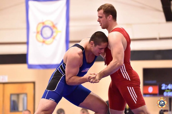 Army Sgt. Pete Gounaridis against Oliver Hassler (Germany) in the 98kg Greco-Roman competition at the 29th CISM World Military Wresting Championship at Joint Base McGuire-Dix-Lakehurst, New Jersey 1-8 October. Gounaridis placed 5th overall, with Hassler (red) won the gold medal.
