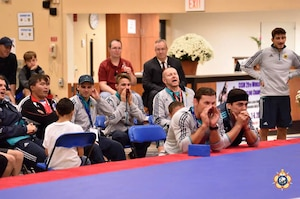 Team Germany cheers on at the 29th CISM World Military Wresting Championship at Joint Base McGuire-Dix-Lakehurst, New Jersey 1-8 October.
