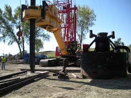 Large-Diameter Auger Rig and Off-gas Collection Equipment (75 Foot Kelly Bar, 150 Ton Crane, Drill Platform & Mixing Rig, Crawler Crane, Off-gas Containment & Collection Shroud, Hardwood Mats, 8 Foot Diameter Auger Bit, Off-gas Low Vacuum Gathering Pipe to Treatment Equipment)
