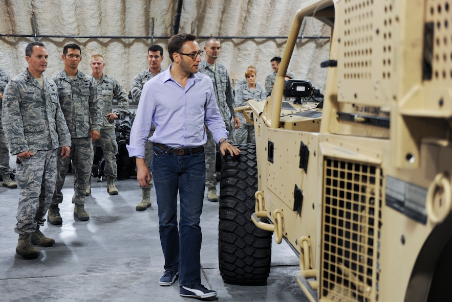 Simon Sinek, an internationally renowned speaker and author, looks inside of a Guardian Angel Air-Deployable Rescue Vehicle while visiting the 58th Rescue Squadron at Nellis Air Force Base, Nev., Oct. 1, 2014. The GAARV is a multi-purpose utility vehicle intended to help combat search and rescue teams retrieve individuals who have been isolated. (U.S. Air Force photo by Airman 1st Class Mikaley Towle)