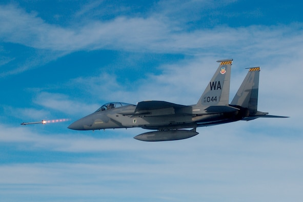 An F-15 Strike Eagle fires a missile during a Weapon System Evaluation Program mission. During the WSEP, the 83rd Fighter Weapons Squadron evaluates the total air-to-air weapons systems, including aircraft, weapon delivery systems, weapons, aircrews, support equipment, technical data and maintenance actions. (Courtesy Photo)