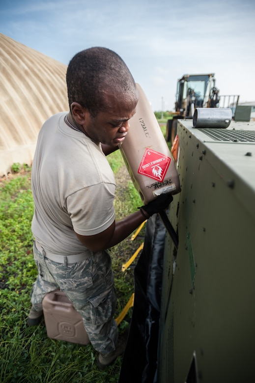 Air Force Senior Airman Quantel Jones of the Kentucky Air National Guard's 123rd Contingency Response Group fuels an electric generator for the Joint Operations Center at Léopold Sédar Senghor International Airport in Dakar, Senegal, Oct. 5, 2014, in support of Operation United Assistance. More than 80 Kentucky Air Guardsmen stood up an Intermediate Staging Base at the airport that will funnel humanitarian supplies and equipment into West Africa as part of the international effort to fight Ebola. (U.S. Air National Guard photo by Maj. Dale Greer)