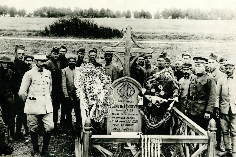 Frencmen and American at Roosevelt's grave after the French had installed a new cross, marker, and fence. (U.S. Air Force photo)