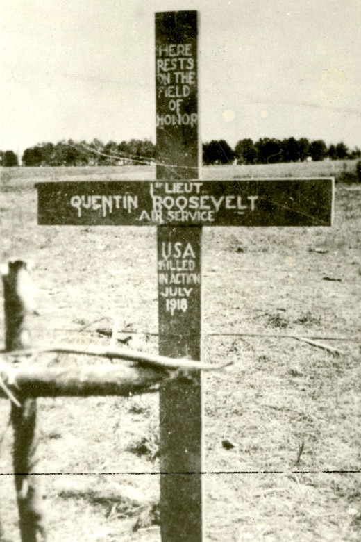 Cross placed on Roosevelt's grave by U.S. troops.  Original German cross appears in the left foreground. (U.S. Air Force photo)