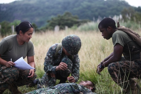 TERNATE, Philippines – U.S. Navy corpsmen instruct a Filipino Corpsman during a bilateral combat life-saver course as part of Amphibious Landing Exercise 15 here, Oct. 4. PHIBLEX is an annual, bilateral training exercise conducted by members of the Armed Forces of the Philippines alongside U.S Marine and Navy forces focused on strengthening the partnership and relationships between the two nations across a range of military operations including disaster relief and complex expeditionary operations. The U.S. corpsmen are with Combat Logistics Battalion 31, 31st Marine Expeditionary Unit.