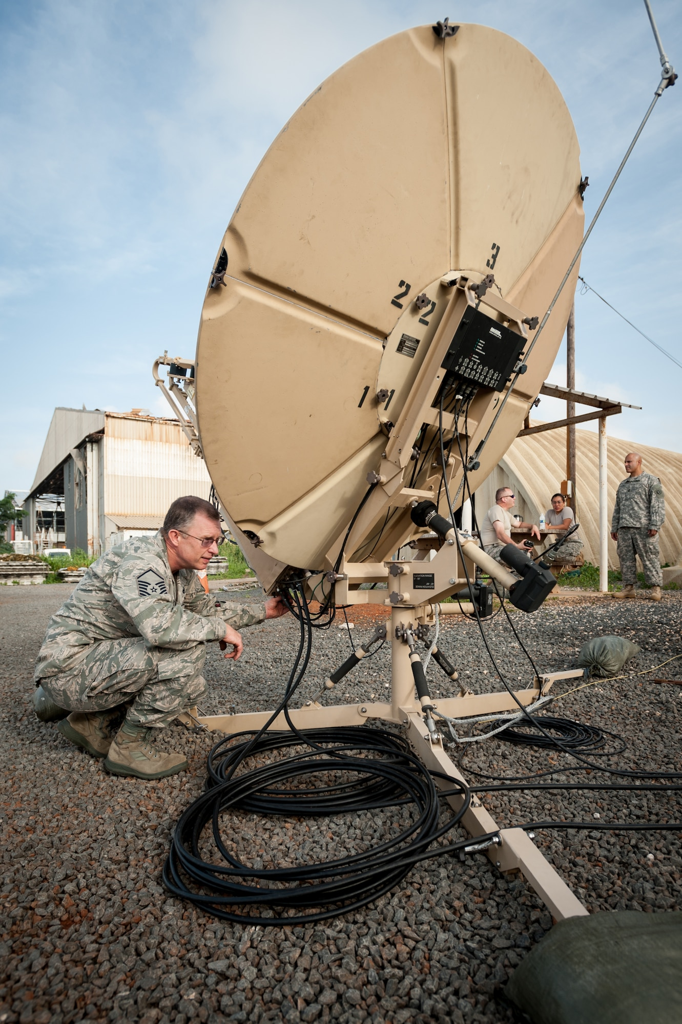 Master Sgt. Paul Edwards establishes satellite communications for the joint operations center Oct. 5, 2014, at Léopold Sédar Senghor International Airport in Dakar, Senegal, in support of Operation United Assistance. More than 80 Airmen from the Kentucky Air National Guard stood up an intermediate staging base at the airport that will funnel humanitarian supplies and equipment into West Africa as part of the international effort to fight Ebola. Edwards is a member of the Kentucky ANG's 123rd Contingency Response Group. (U.S. Air National Guard photo/Maj. Dale Greer)