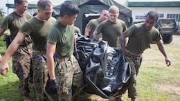 U.S. Navy corpsmen carry a tent that will be used for a shock trauma aid station during Amphibious Landing Exercise 15 here Sept. 30. PHIBLEX is an annual, bilateral training exercise conducted by members of the Armed Forces of the Philippines alongside U.S Marine and Navy forces focused on strengthening the partnership and relationships between the two nations across a range of military operations including disaster relief and complex expeditionary operations. The corpsmen are with Combat Logistics Battalion 31, 31st Marine Expeditionary Unit.