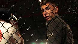New Orleans - John Zimmer, a security specialist at Headquarters Battalion, Marine Forces Reserve, stands in the octagon minutes before his fight at the Caged Warrior Championship V on Oct. 4th, 2014, in Patterson, La. This was Zimmer's first time competing in a mixed martial arts fight.
