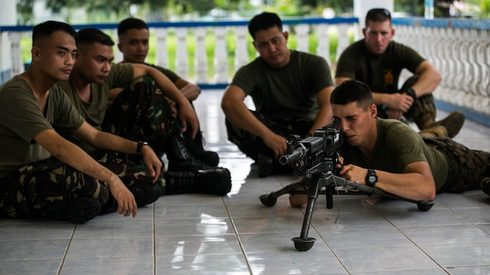 Philippine airmen and U.S. Marines familiarize themselves with the M240G medium machine gun Oct. 3 at Basa Air Base, Philippines. The service members shared best practices in several areas, including weapons handling, airbase ground defense, and jungle warfare tactics as part of a training event taking place during Amphibious Landing Exercise 2015. PHIBLEX 15 is an annual bilateral training event conducted to improve interoperability and strengthen the bond between the Philippines and U.S. The U.S. Marines are with Marine Wing Support Squadron 172, Marine Air Group 36, 1st Marine Aircraft Wing. The Philippine airmen are with the Air Defense Wing.
