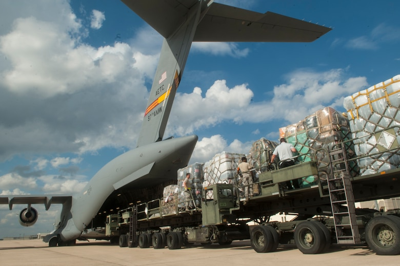 Medical supplies from the Air Force Medical Operations Agency are loaded onto a C-17 Globemaster III  Sept. 26, 2014, at Joint Base San Antonio-Lackland, Texas. The C-17 is assigned to the 97th Air Mobility Wing, deployed from Altus Air Force Base, Okla., and supported Operation United Assistance. (U.S. Air Force photo/Airman Justine K. Rho)
