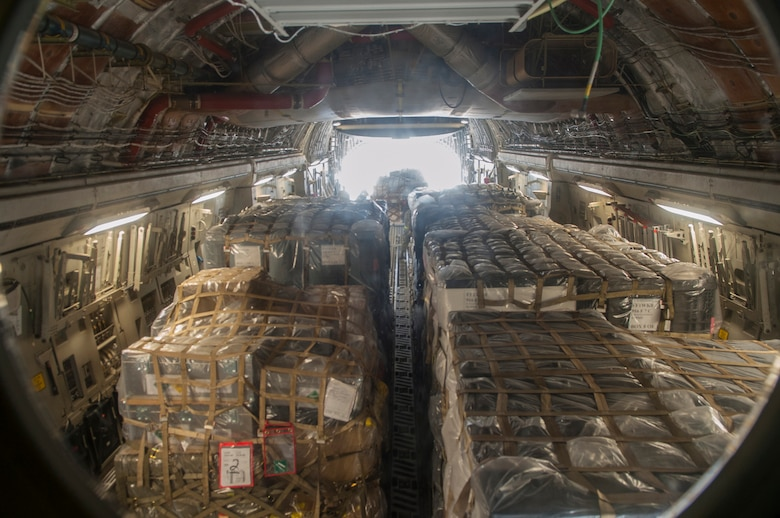 Medical supplies from the Air Force Medical Operations Agency are loaded onto a C-17 Globemaster III Sept. 26, 2014, at Joint Base San Antonio-Lackland, Texas. The supplies were being sent in support of Operation United Assistance to help treat patients and halt the spread of the Ebola virus. The supplies will support field hospitals and aid workers battling the virus in Monrovia, Liberia. The C-17 is assigned to the 97th Air Mobility Wing. (U.S. Air Force photo/Airman Justine K. Rho