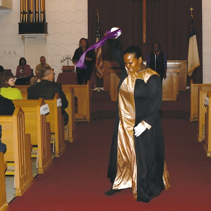 """Praise Dancer Esheka Harper performs to the song entitled, """"Tired,"""" by Kelly Price during the Domestic Violence Awareness Proclamation and Motorcycle Ride held Sept. 30 at the Chapel of the Good Shepherd on base."""