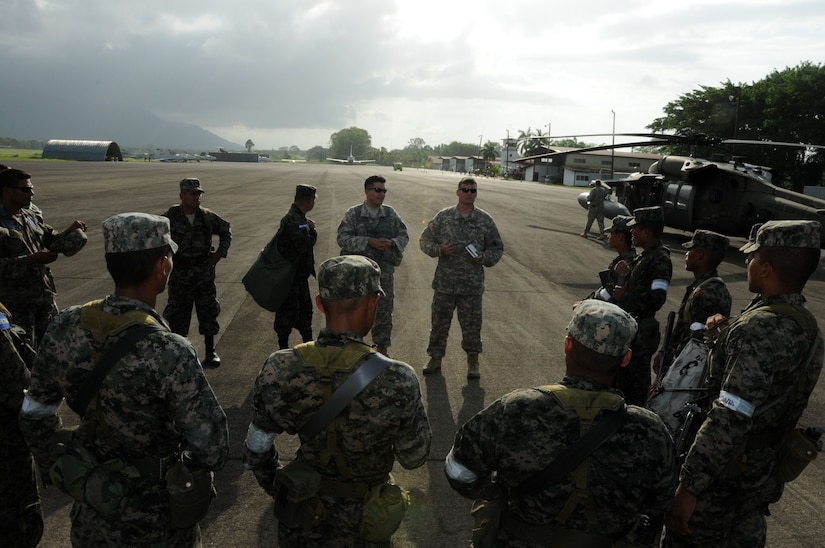 A U.S. Army aviation crew briefs flight safety to Honduran service members October 6 before boarding a UH-60 Blackhawk during Operation Caravana.  Operation Caravana's sole purpose is to provide the Honduran military freedom of movement and access to the isolated areas in Gracias a Dios, Colon and Olancho in order to continue their security operations.  These troop movements and logistics re-supply flights will occur on an as-needed basis.  (Photo by U.S. Air National Guard Capt. Steven Stubbs)