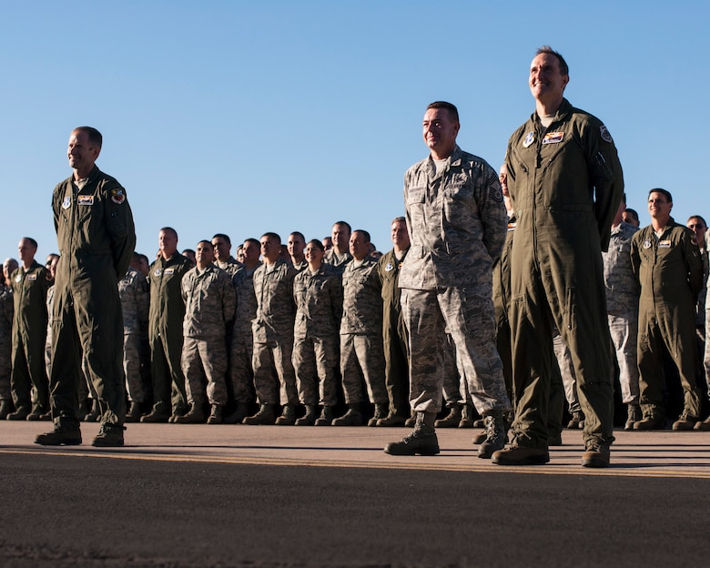 """Citizen-Airmen converged at the Tucson International Airport to be captured on digital imagery Oct. 5. """"There are plenty of videos of fighter jets in formation or pararescue specialists jumping out of planes that are all stunning visuals,"""" said Staff Sgt. Dina Farmer, public affairs specialist, """"But sometimes, a still picture of Airmen can say a lot as well."""" (U.S. Air National Guard photo taken by Staff Sgt. Gregory Ferreira)"""