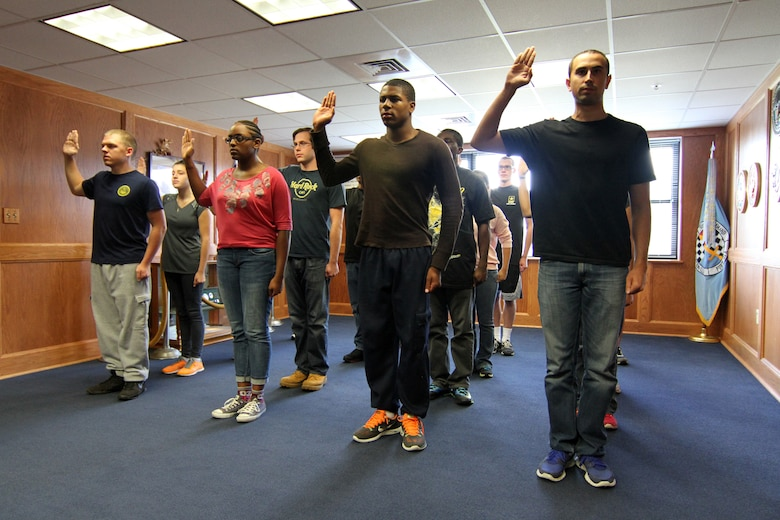 Applicants are sworn into service at the Military Entrance Processing Station on Joint Base McGuire-Dix-Lakehurst, N.J., Oct. 7, 2014. (U.S. Army photo by Sgt. Richard W. Hoppe/Released)