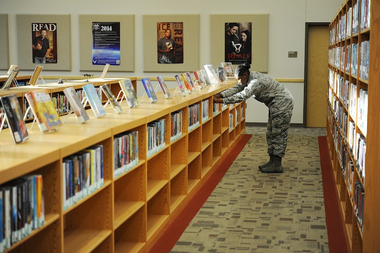 GOODFELLOW AIR FORCE BASE, Texas – Airman Jesyka Ware, 315th Training Squadron student, browses through a bookshelf at the base library Sept. 30. After school, Ware sometimes goes to the library to enjoy a quiet environment to decompress from her classes. (U.S. Air Force photo/ Airman 1st Class Devin Boyer)